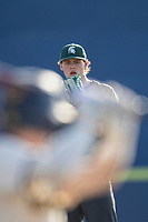 Michigan State pitcher Adam Berghorst (44) looks to his catcher for the sign against the Michigan Wolverines on March 21, 2021 in NCAA baseball action at Ray Fisher Stadium in Ann Arbor, Michigan. Michigan scored 8 runs in the bottom of the ninth inning to defeat the Spartans 8-7. (Andrew Woolley/Four Seam Images)