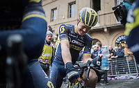 Chris Juul Jensen (DEN/Orica-Scott) trying to releaf his eyes after finishing with all the mud that was thrown around<br /> <br /> 11th Strade Bianche 2017