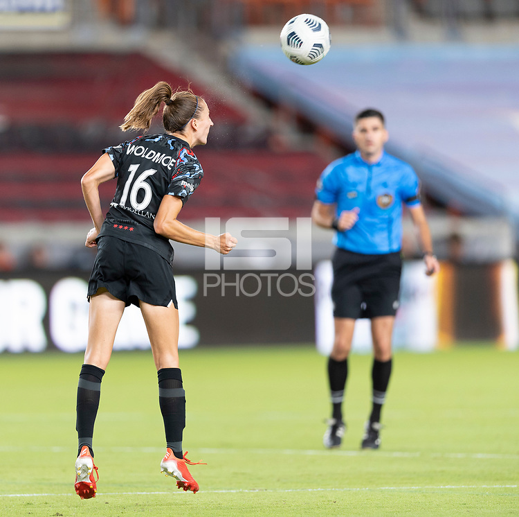 HOUSTON, TX - SEPTEMBER 10: Sarah Woldmoe #16 of the Chicago Red Stars heads the ball up the field during a game between Chicago Red Stars and Houston Dash at BBVA Stadium on September 10, 2021 in Houston, Texas.