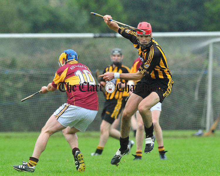 Niall Keane of Ballyea evades the challenge of Tulla's Eanna Tarpey. Photograph by Declan Monaghan