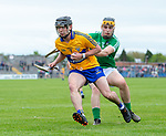 Pauric Mc Namara of Clare in action against Brian Ryan of Limerick during their Munster U-21 hurling quarter final at Cusack park. Photograph by John Kelly.