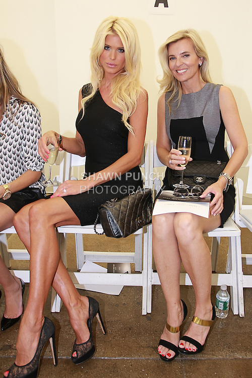 Model Victoria Silvstedt (left) and guest attend the Carmen Marc Valvo Spring 2013 collection fashion show, during Mercedes-Benz Fashion Week Spring 2013.