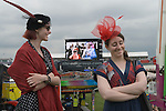 Ladies Day at The Derby horse race. Epsom Down Surrey UK. The Queen and Queen Mother on broadcast screen to celebrate the Diamond Jubilee.