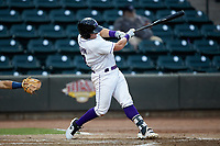 Andrew Vaughn (12) of the Winston-Salem Dash follows through on his swing against the Lynchburg Hillcats at BB&T Ballpark on August 1, 2019 in Winston-Salem, North Carolina. The Dash defeated the Hillcats 9-7. (Brian Westerholt/Four Seam Images)