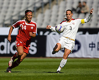 Melissa Tancredi of Canada and Christie Rampone of the USA. The U.S. defeated Canada, 4-0, during the Four Nations Tournament in Guangzhou, China on January 16, 2008.