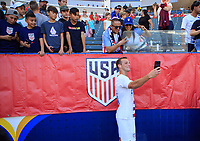 CARSON, CA - FEBRUARY 1: Chase Gasper #21of the United States taking selfies and celebrating with fans during a game between Costa Rica and USMNT at Dignity Health Sports Park on February 1, 2020 in Carson, California.