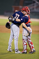 Hagerstown Suns relief pitcher Koda Glover (37) gets a hug from catcher Matt Reistetter (15) after closing out the win over the Kannapolis Intimidators at CMC-Northeast Stadium on July 19, 2015 in Kannapolis, North Carolina.  The Suns defeated the Intimidators 9-4.  (Brian Westerholt/Four Seam Images)