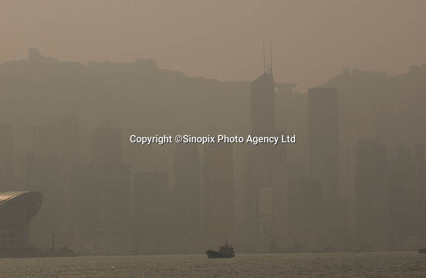 """Pollution, smog and haze hangs over Hong Kong's Victoria harbour at 2.00pm in the afternoon on a """"sunny and clear"""" day in Hong Kong. Pollution in Hong Kong has been steadily increasing along with the industrialization of China. Clear views from the Hong Kong Peak, a major tourist destination are rare and pollution is now cited as a major reason for people leaving Hong Kong..18-JAN-05"""