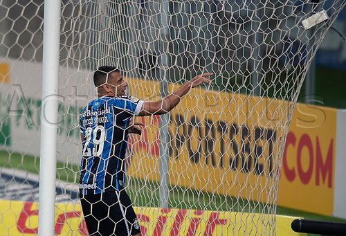 14th November 2020; Arena de Gremio, Porto Alegre, Brazil; Brazilian Serie A football league, Gremio versus Ceara; Diego Souza of Gremio celebrates his goal in the 40th minute 3-1 as he tangles in the net
