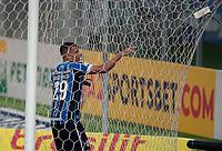 14th November 2020; Arena de Gremio, Porto Alegre, Brazil; Brazilian Serie A football league, Gremio versus Ceara; Diego Souza of Gremio celebrates his goal in the 40th minute 3-1 as he tangles in the net