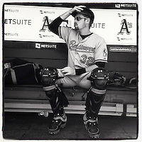 OAKLAND, CA - APRIL 28:  Instagram of Matt Wieters of the Baltimore Orioles getting ready in the dugout before the game against the Oakland Athletics at O.co Coliseum on April 28, 2013 in Oakland, California. Photo by Brad Mangin