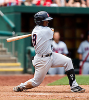 Jean Segura (8) of the Arkansas Travelers follows through his swing during a game against the Springfield Cardinals at Hammons Field on May 8, 2012 in Springfield, Missouri. (David Welker/ Four Seam Images).