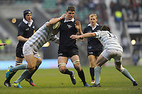 Will Rowlands of Oxford University is tackled by Courtenay Morrison of Cambridge Universityduring the 132nd Varsity Match between Oxford University and Cambridge University at Twickenham Stadium on Thursday 13th December 2013 (Photo by Rob Munro)