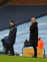 10th January 2021; Etihad Stadium, Manchester, Lancashire, England; English FA Cup Football, Manchester City versus Birmingham City; Birmingham City manager Aitor Karanka and Manchester City manager Pep Guardiola  follow the action from the touchline