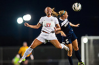FC Kansas City defender Merritt Mathias (9) goes up for a header with Sky Blue FC defender Kendall Johnson (5). Sky Blue FC and FC Kansas City played to a 2-2 tie during a National Women's Soccer League (NWSL) match at Yurcak Field in Piscataway, NJ, on June 26, 2013.