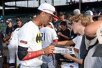 Anthony Molina (23) of Somerset Academy in Pembroke Pines, Florida signs autographs before the Under Armour All-American Game on August 16, 2014 at Wrigley Field in Chicago, Illinois.  (Mike Janes/Four Seam Images)