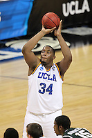 UCLA Bruins Joshua Smith #34 takes a free throw attempt during the second round game of the NCAA Basketball Tournament at St. Pete Times Forum on March 17, 2011 in Tampa, Florida.  UCLA defeated Michigan State 78-76.  (Mike Janes/Four Seam Images)