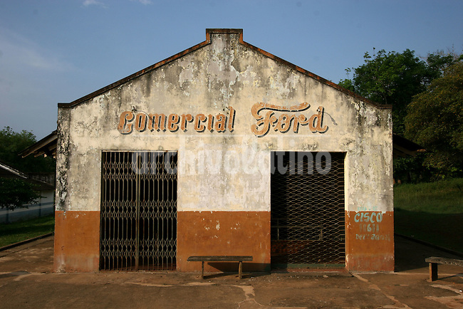 A store uses the name of the auto maker in Fordlandia, a former factory town created by the Ford Motor Company on the banks of the Tapajós River, September 6, 2005. Deep in the Amazon forest, 12 hours by boat from the regional capital of Santarem in Brazil's Pará state, the rubber plantation and processing factory is now abandoned to the rain-forest, an aging memorial to American ideals and to the Brazilian reality. It almost seems like time has stopped in Fordlandia, or better yet, time has passed it by. In typical american style, it was organized and efficient, an idea admired by many Brazilians, and perhaps more so by residents of the untamed Amazon. But It is an idea hard to implement in the wilds of the amazon. Some might also say that it is also a typical American style the way Ford came here and tried to implement something with little knowledge of the local customs or terrain. From 1928 to 1945, Ford came tried to take control of his rubber supply, one of the most important products of the rainforest. After only 17 years the company admitted defeat and retreated from the forest.