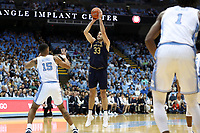 CHAPEL HILL, NC - NOVEMBER 06: John Mooney #33 of the University of Notre Dame shoots a jump shot over Garrison Brooks #15 of the University of North Carolina during a game between Notre Dame and North Carolina at Dean E. Smith Center on November 06, 2019 in Chapel Hill, North Carolina.
