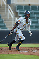 Oneil Cruz (7) of the West Virginia Power follows through on his swing against the Kannapolis Intimidators at Kannapolis Intimidators Stadium on July 25, 2018 in Kannapolis, North Carolina. The Intimidators defeated the Power 6-2 in 8 innings in game one of a double-header. (Brian Westerholt/Four Seam Images)