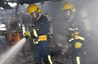 Firefighters wearing Breathing Apparatus inside a static home dealing with a severe fire. This image may only be used to portray the subject in a positive manner..©shoutpictures.com..john@shoutpictures.com