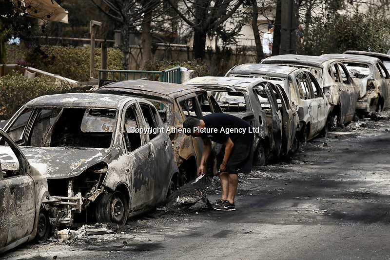 Pictured: the aftermath of the forest fire which has claimed dozens of lives in the Mati area of Rafina, Greece. Tuesday 24 July 2018<br /> Re: Deaths caused by wild forest fires throughout Greece.