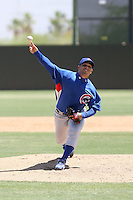 Juan Serrano, Chicago Cubs 2010 extended spring training. Serrano, pitching against the Athletics at Papago Park, Phoenix, AZ - 05/25/2010. Serrano signed with the Cubs  after defecting from his native Cuba..Photo by:  Bill Mitchell/Four Seam Images.