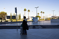 LISBON, PORTUGAL - June 7: A person waits for transportation at the Airport in Lisbon, on June 7, 2021. <br /> Tourists anticipated trips from Lisbon to the U.K. They decided to return early so they wouldn't have to quarantine. since the new rules were announced for those traveling from Portugal to the UK. <br /> (Photo by Luis Boza/VIEWpress)