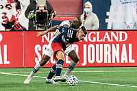 FOXBOROUGH, MA - NOVEMBER 20: Gustavo Bou #7 of New England Revolution and Rod Fanni #7 of Montreal Impact battle for the ball during the Audi 2020 MLS Cup Playoffs, Eastern Conference Play-In Round game between Montreal Impact and New England Revolution at Gillette Stadium on November 20, 2020 in Foxborough, Massachusetts.(Photo by Andrew Katsampes/ISI Photos/Getty Images).