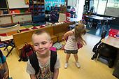 MR / Schenectady, NY. Zoller Elementary School (urban public school). Kindergarten classroom. Portrait of boy (5) in classroom as students prepare for dismissal. MR: Hol3. ID: AM-gKw. © Ellen B. Senisi.