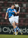 St Johnstone's Steven MacLean and Hearts' Danny Wilson challenge for the ball.