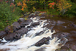 Pattison State Park, WI<br /> Rushing white water tumbles on wet rocks on the Black River in early autumn