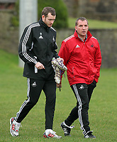 FAO SPORTS PICTURE DESK<br /> Pictured: Manager Brendan Rodgers (R) with Craig Beattie (L). Thursday 12 January 2012<br /> Re: Premier League football side Swansea City FC training session at Llandarcy, south Wales.