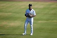 Charleston RiverDogs right fielder Garrett Hiott (8) warms up between innings of the game against the Augusta GreenJackets at Joseph P. Riley, Jr. Park on June 27, 2021 in Charleston, South Carolina. (Brian Westerholt/Four Seam Images)