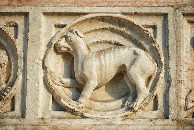 Medieval relief sculptures of mythical creatures on the exterior of the Romanesque Baptistery of Parma, circa 1196, (Battistero di Parma), Italy