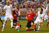 7 June 2011: USA Men's National Team midfielder Michael Bradley (4), Canada midfielder Dwayne De Rosario (14) defender Andre Hainault (5) and USA Men's National Team defender Carlos Bocanegra (3) go for the ball during the CONCACAF soccer match between Panama and Guadeloupe at Ford Field Detroit, Michigan.