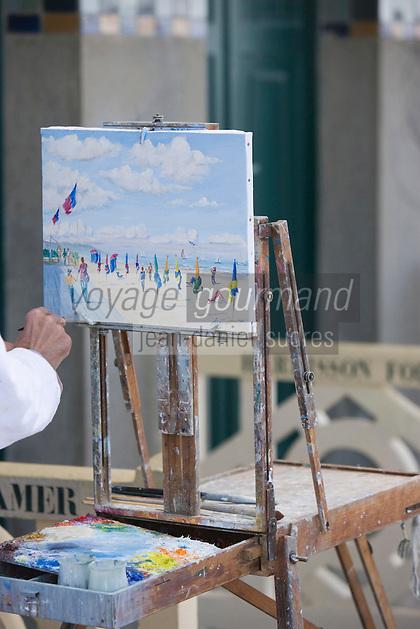 Europe/France/Normandie/Basse-Normandie/14/Calvados/Pays d'Auge/Deauville: Peintre et son chevalet  sur les planches peignant la plage de Deauville
