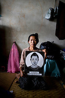 "When Cyclone Nargis hit the Irrawaddy Delta on 02/05/2008, all 47 year old Daw Myue Kyig brought with her was this picture of Buddha. ""Buddha saved us,"" she says. Daw's daughter, Thanda gave birth to a baby girl on the day of the storm. ""Even in this chaos, my daughter was blessed with a baby It was Buddha's blessings that we are still alive, he will see us through this too."" Daw lives alongside other refugees from the 7th ward, Hlaingthaya township in Rangoon (Yangon), in the Shwe Than Lwin shopping complex, which is under construction and has acted as a small refugee centre."