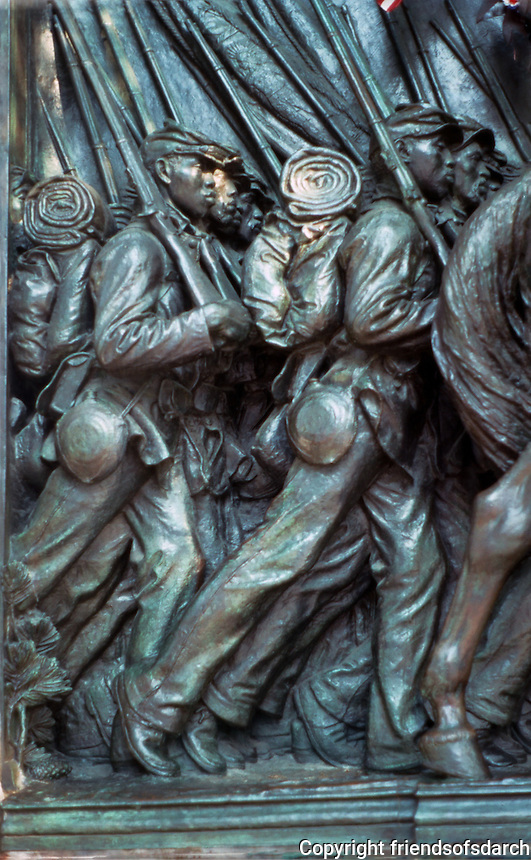 Boston:  Massachusetts 54th Memorial--detail.  Bronze Sculpture by Augustus Saint-Gaudens, 1894-1898.  Located in Boston Commons in honor of Robert Gould Shaw and his regiment.  Set in monument designed by architect Charles F. McKim.  Photo '88.