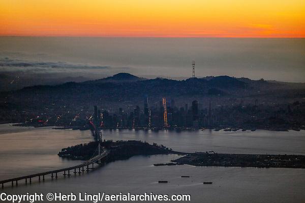 aerial photograph San Francisco at dusk, California, with the Bay Bridge, Yerba Buena and Treasure Island in the foreground