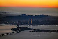 aerial photograph San Francisco at dusk, California, with the Bay Bridge, Yerba Buena and Treasure Island in the foreground