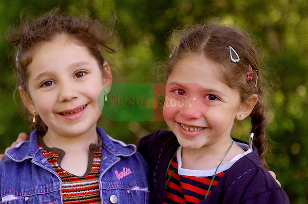 portrait of two 11 year old girls smiling