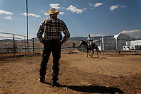 "Wild horses are gentled at the Warm Springs Correctional Center, a minimum security prison.  Hank Curry has run the horse training program for more than 5 years.  He has selected 500 horses, only 5 had to be returned.  Many have been adopted and are ridden.  The horses and inmates learn life lessons.  Horses learn from repetition and adjust to new things. As Hank says, ""It's about as exciting as watching paint dry.  We bore them into submission."""