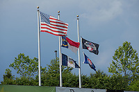 Flags fly beyond the left field wall at L.P. Frans Stadium, home of the Hickory Crawdads, prior to the game against the Rome Braves on May 12, 2016 in Hickory, North Carolina.  The Braves defeated the Crawdads 3-0.  (Brian Westerholt/Four Seam Images)