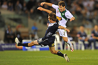 MELBOURNE, AUSTRALIA - FEBRUARY 5, 2010: Evan Berger from Melbourne Victory going for the ball in round 26 of the A-league match between Melbourne Victory and North Queensland Fury at Etihad Stadium on February 5, 2010 in Melbourne, Australia. Photo Sydney Low www.syd-low.com