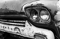 Headlights and Grill of a 1959 Chevy 2 Ton Truck in Hill City, Idaho.