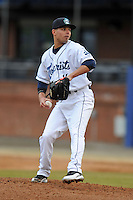 Asheville Tourists pitcher Marc Magliaro #14 delivers a pitch during game one of a double header against the West Virginia Power at McCormick Field on April 8, 2014 in Asheville, North Carolina. The Power defeated the Tourists 6-5. (Tony Farlow/Four Seam Images)