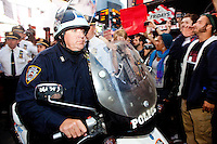 "Policemen on scooters are forced to retreat after failing to control a crowd of protesters with ""Occupy Wall Street"" at Times Square on October 15, 2011 in New York City.  While crowd estimates numbered in the tens of thousands, police tactics (including nets, motor scooters, barricades, arrests, and intimidation by riders on horseback) prevented the crowd, which had been split up, from joining together as one in the middle of Times Square."