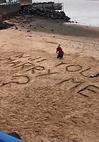 Moment lovestruck Andy Bennett proposed to his girlfriend on a windswept Devon beach.