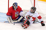 Sochi, RUSSIA - Mar 11 2014 -  Billy Bridges attempts a deflection as Canada takes on Czech Republic in Sledge Hockey at the 2014 Paralympic Winter Games in Sochi, Russia.  (Photo: Matthew Murnaghan/Canadian Paralympic Committee)